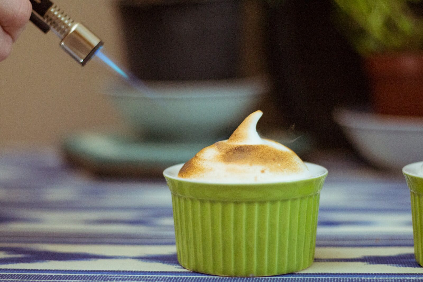 Brown marshmallows with a cooking torch.